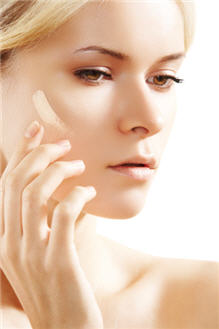 woman applying a creamy, natural foundation